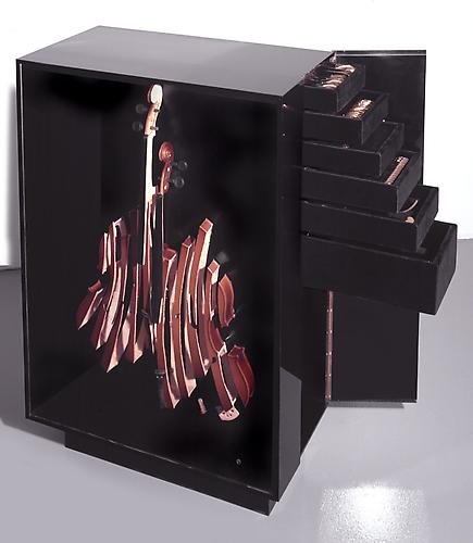 ARMAN Violon Ménagère, 1973  Gold plated silver tableware in Plexiglas box with sliced wood violin, comprising 116 pieces including 8 service pieces, Case: 35 x 22 x 11.5 in., Editioned in 1973, number 94 from an edition of 99   View More  ➤