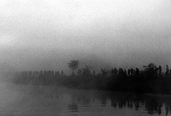 Rwandan refugee camp at Benako.  Early in the mroning, thousands of Rwandans walk to the lake near the camp to collect water, Tanzania 1994 gelatin silver print