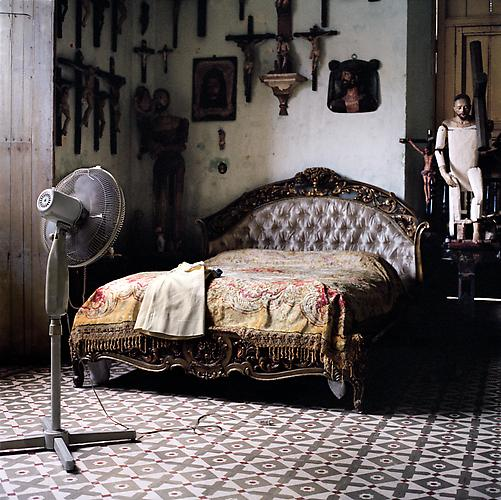 OLGA CHAGAOUTDINOVA | BED, CROSSES AND A FAN | C-PRINT | 61 x 61 CENTIMETERS | 2007