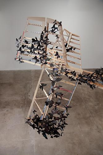 "Paul Villinski, Passage, 2011 Salvaged wood, found aluminum cans, wire, soot, steel 3'-2"" x 15'-4"" x 33'"