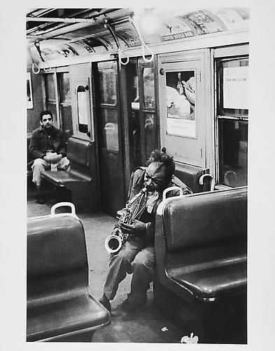 Man playing saxophone on subway  mid 1950s Gelatin Silver Print