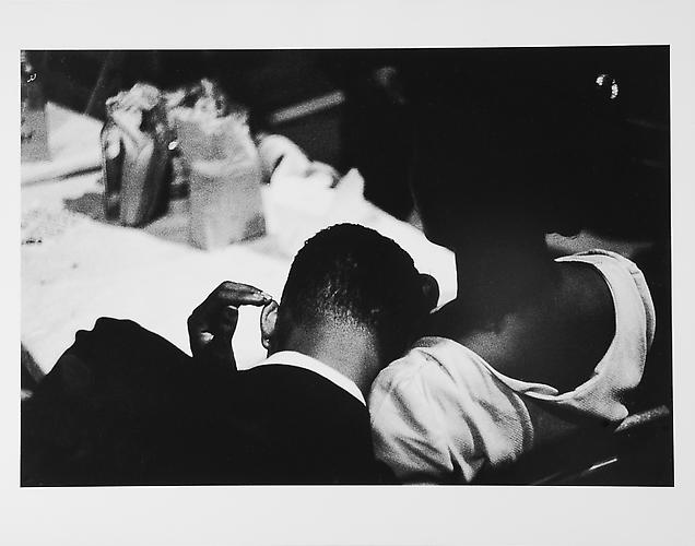 Woman touching man's ear mid 1950s Gelatin Silver Print