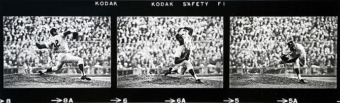 Sandy Koufax pitches in game 7 of the World Series, in Minneapolis vs. The Twins, on Thursday, October 14th, 1965.  The Dodgers win the series in 7 games, final score, 2-0