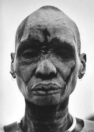 Dinka man at the cattle camp of Kei. People cover themselves with ash to sterilize the skin against insects and parasites, Southern Sudan 2006 gelatin silver print