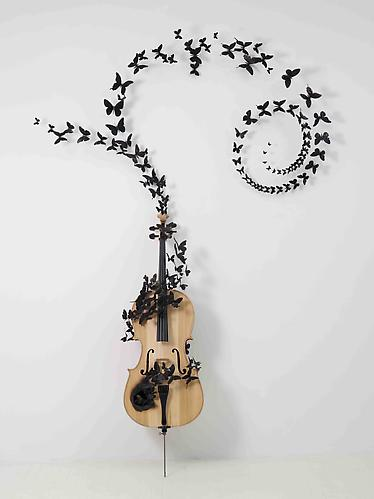 Paul Villinski, Fable  (2011) Cello, Aluminum (found Cans), Stainless Steel Wire And Soot  96h x 65w x 16d in (243.84h x 165.1w x 40.64d cm)