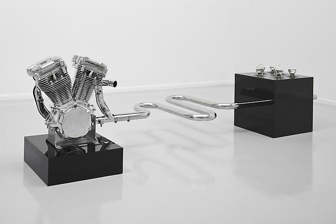 Fear of Drowning, 2010 Harley Davidson (AVO) motorcycle engine, stainless steel, polyester, medical glass cup, acrylic 38 x 29 x110 inches