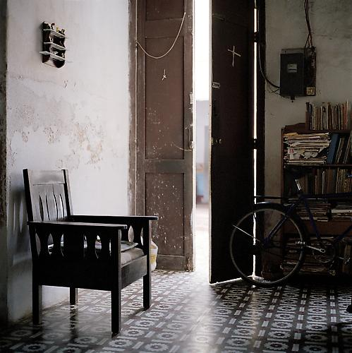 OLGA CHAGAOUTDINOVA | WOODEN CHAIR NEAR ENTRANCE | C-PRINT | 61 x 61 CENTIMETERS | 2007