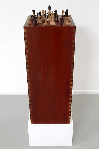 Padauk Walnut Pedestal with Chess Set, 2013 Pedestal: Padauk and Walnut, Chess pieces: Canary, mixed 14 x 14 x 35 ½ in