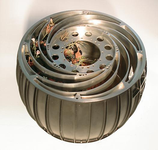 Wheel Of Optimism, 2006 Milled Aluminum Tire From NASA Mars Rover, Hematite Rocks, Artificial Plants, and Photo 9 x 9 x 8 inches Commissioned by NASA