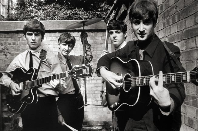The Beatles Posing in a Small Backyard in London with Instruments