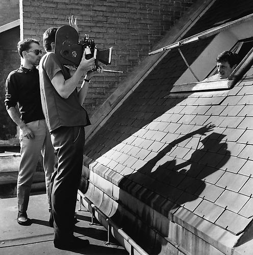 Godard directs Belmondo through the window of a house in the 16th arrondissement of Paris (A Bout De Souffle) 1959 gelatin silver print