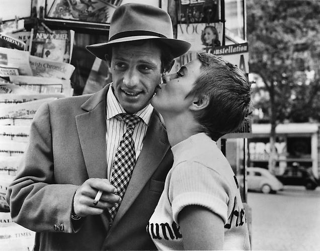 Jean-Paul Belmondo and Jean Seberg kiss in front of a kiosk on the Camps Elysees (A Bout De Souffle) 1959 gelatin silver print