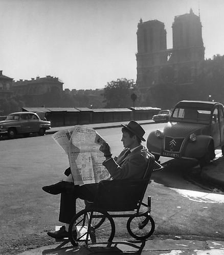 Jean-Paul Belmondo on standby, in between takes, not far from Notre Dame (A Bout De Souffle) 1959 gelatin silver print