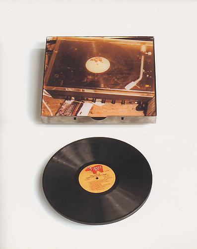 DENNIS ADAMS Lullaby, 2004  Vinyl record weighted with steel plate to retard the speed of a turntable 30 x x40 x 8 in., AP I/II, edition of 10