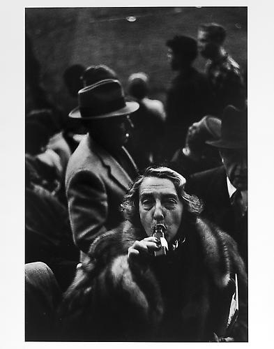 Woman drinking from bottle after game, Ebbetts Field, Brooklyn  mid 1950s Gelatin Silver Print