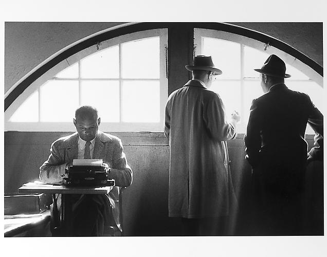 Sprits writers, one at typewriter  mid 1950s Gelatin Silver Print