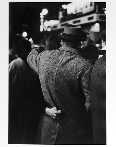Woman with hand on man's back mid 1950s Gelatin Silver Print