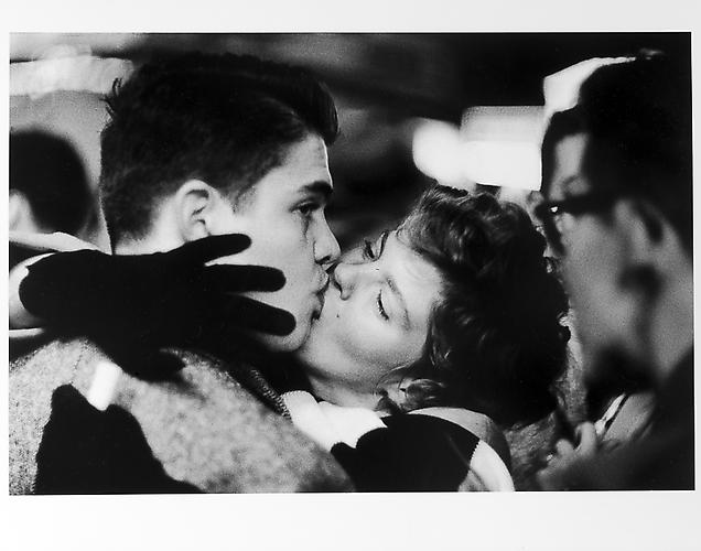 Couple kissing, man looking away, New Year's Eve mid 1950s Gelatin Silver Print