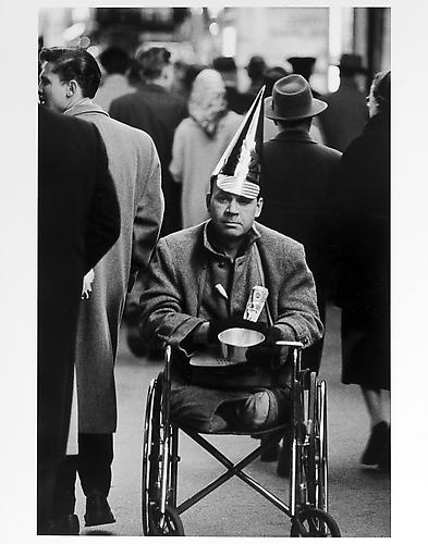 Man with no legs and party hat, New Year's Eve mid 1950s Gelatin Silver Print