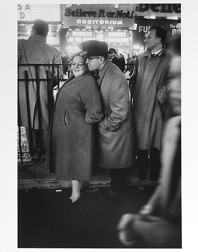 "Couple under ""believe it or not"" sign, New Year's Eve mid 1950s Gelatin Silver Print"