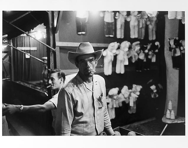 Man in cowboy hat at street fair  mid 1950s Gelatin Silver Print