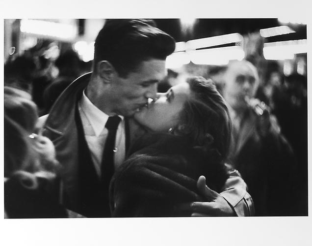 Couple kissing, man with horn, New Year's Eve mid 1950s Gelatin Silver Print