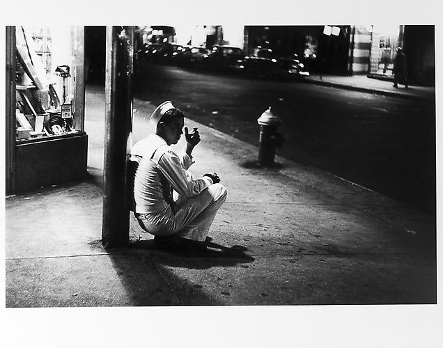 Sailor squatting, leaning against pole  mid 1950s Gelatin Silver Print