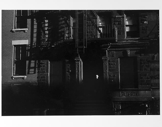 Facade of building, small white face in shadows  mid 1950s Gelatin Silver Print