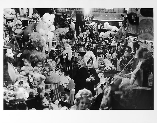 Girl in doll shop on Halloween  mid 1950s Gelatin Silver Print