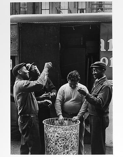 Moving men looking at pictures  mid 1950s Gelatin Silver Print