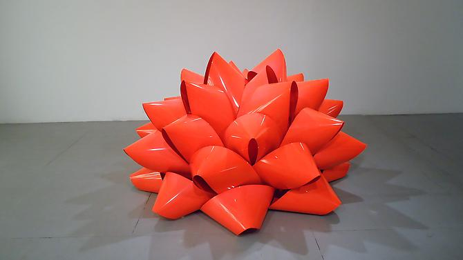 Piper Brett Love Me, 2009. 22 Gage sheet steel, powder coated florescent red, 42 x 72 x 72 inches.