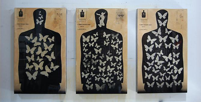 Combat Target / Master Butterfly Plates, 2011 Pistol targets, magazine print, paint, coffee and resin on wood panel 35 x 21 x 3; each
