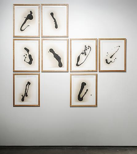 Untitled , 2009, installation view, motor oil on paper and artist studio frames, 8 panels, 29 x 22 inches each