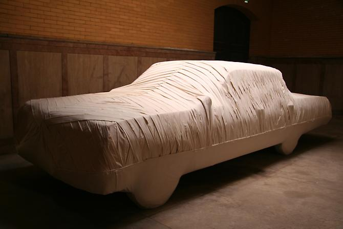 Jay Critchley,  FINAL PASSAGE , 2008 1965 Chevy Impala, mummified, muslin, mixed media, installed in an abandoned mausoleum, North Burial Ground, Providence, Rhode Island