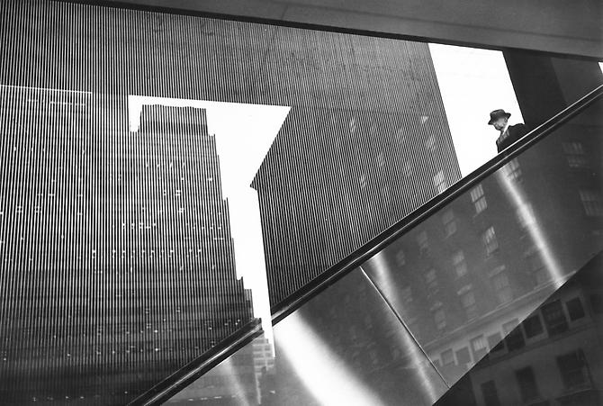 Man on Escalator, Park Avenue 1961 gelatin silver print