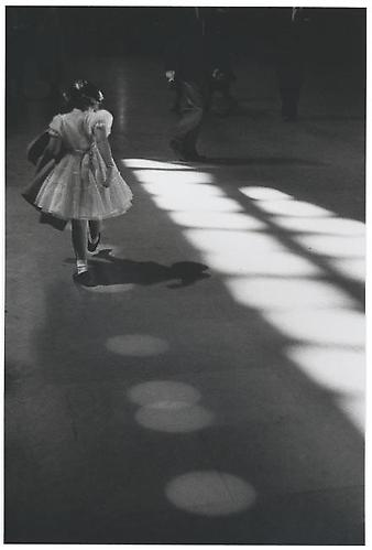 Girl Playing in Light Circles  1958 gelatin silver print