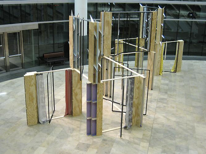 Heather Rowe Tenuous Arrangements 2010  wood, steel, mirror, sheetrock, rug, carpet padding, molding Installation View: Tenuous Arrangements, Indianapolis Museum of Art, Indianapolis, IN. February 19 - August 1, 2010.