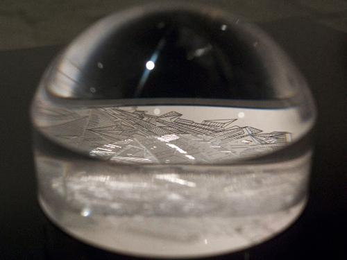 Crossing the Ocean in a Glass of Water , 2010, detail, cuts on plexiglas dome, plexiglas sheet (18 x 18 inches), wooden pedestal (18 x 18 inches)