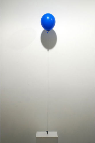 Liliana Porter, 2010, The Riddel (Man with Balloon) , Figurine and helium balloon on wooden base, Base: 12 x 9 x 1 inches Balloon height variable at approx. 70 inches high