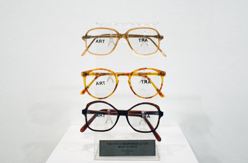 Paulo Bruscky, 2010 , The eye is responsible for what it sees , 3 pairs of glasses, stickers, acrylic 9.4 x 3.9 x 3.1 inches