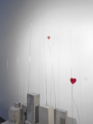 Garden of Infinite Hearts , 2007, detail, cement, steel wire, clock movement, found objects, wire, acetate