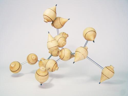 Trompos I , 2008, wood and aluminum, 19 x 11 x 15 inches