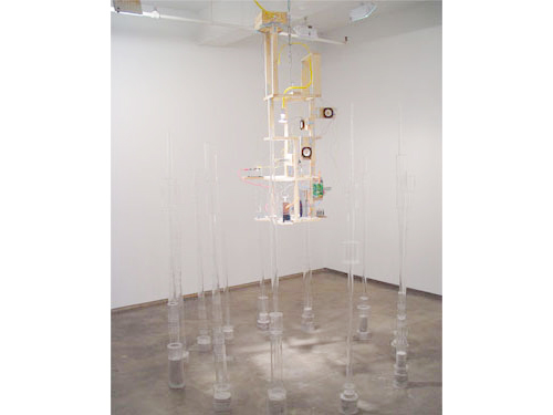 Un-Time Structure , 2004, Plexiglas, optical lenses, clock motors, light, wood, speakers, amplifiers, contact microphones, Mylar, 11 x 6 x 6 feet