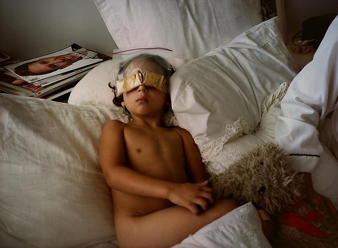 Gillian Laub,  Cooper with Wheat Thins , 2002 C-print 30 x 40 inches / 76 x 101 cm Edition of 5