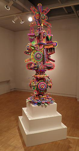 Lodestar,  2011 foam, plaster, acrylic, paper, mirror, glue and rotating base 120 x 36 x 36 inches