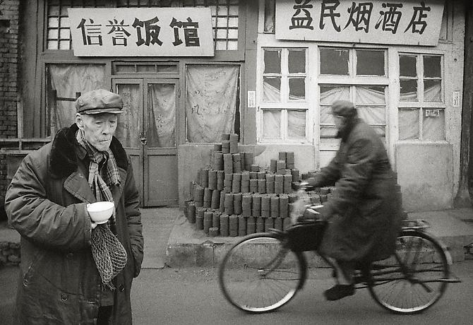 Man with bowl and cyclist, Beijing 1989 gelatin silver print