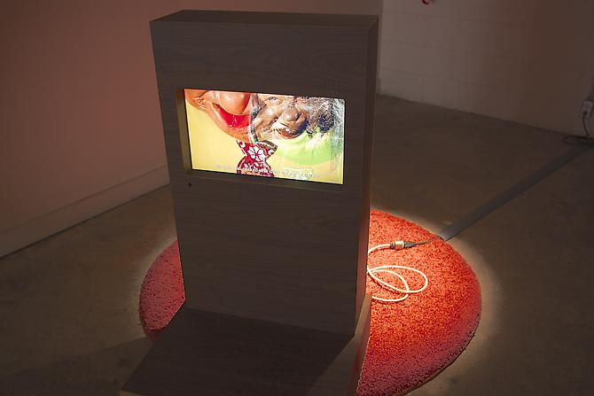 George Jenne  Memorial for Plastic , 2012 Wood, urethane, carpet, video and light 46 x 48 x 57 inches