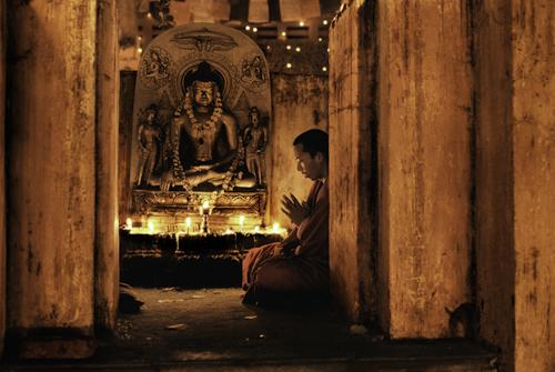 Monk praying at Bodh Gaya 2000 C-type print on Fuji Crystal Archive paper