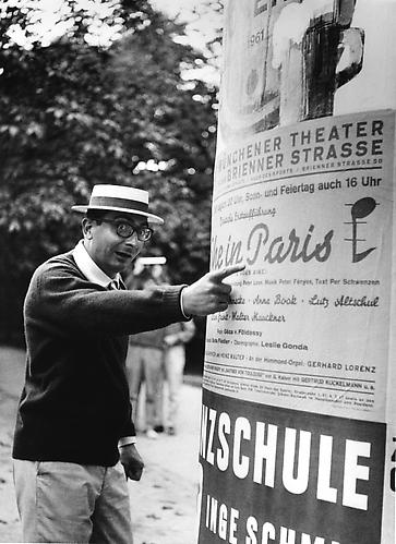 Claude Charbol wearing a French straw had during filming in Munich, Germany (L'Oeil Du Malin) 1961 gelatin silver print