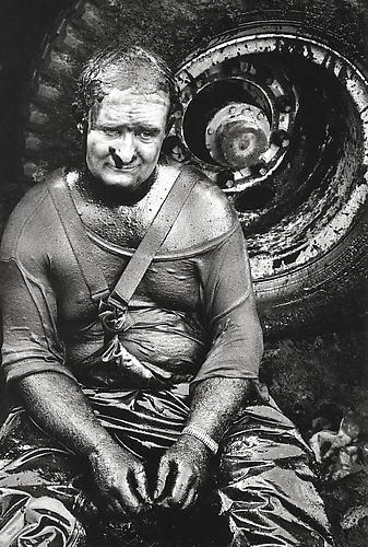 Greater Burhan Oil Field, Kuwait (Worker sitting covered in oil) 1991 gelatin silver print